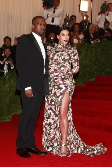 "Kanye West and Kim Kardashian arrive at the Metropolitan Museum of Art Costume Institute Benefit celebrating the opening of ""PUNK: Chaos to Couture"" in New York, May 6, 2013. (Carlo Allegri/Reuters)"