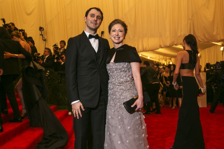 "Chelsea Clinton arrives with husband Marc Mezvinsky at the Metropolitan Museum of Art Costume Institute Benefit celebrating the opening of ""PUNK: Chaos to Couture"" in New York, May 6, 2013. (Lucas Jackson/Reuters)"