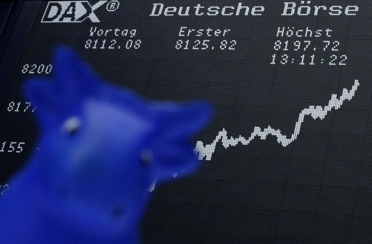 A bull figure is pictured in front of the German share price index DAX board at the German stock exchange in Frankfurt. Germany's top stock index hit a record high on Tuesday, the first major European market to top peaks hit before the financial crisis hammered share values. The blue-chip DAX, packed with in-demand international exporters, hit an intraday high of 8,160.14 points, passing its previous best of 8,151.57 points for the first time since mid-2007. (Lisi Niesner/Reuters photo)