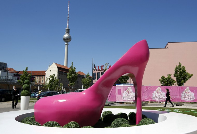 "A giant shoe is pictured outside a life-size ""Barbie Dreamhouse"" of Mattel's Barbie dolls in Berlin. The life-sized house, covering about 1,400 square metres offers visitors to try on Barbie's clothes in her walk-in closet, tour her living room and her kitchen. (Fabrizio Bensch/Reuters)"