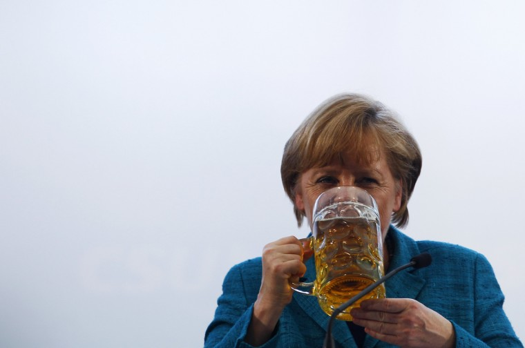 German Chancellor and head of the Christian Democratic Union (CDU) Angela Merkel drinks a beer after her speech in a beer tent in Munich. (Michaela Rehle/Reuters photo)