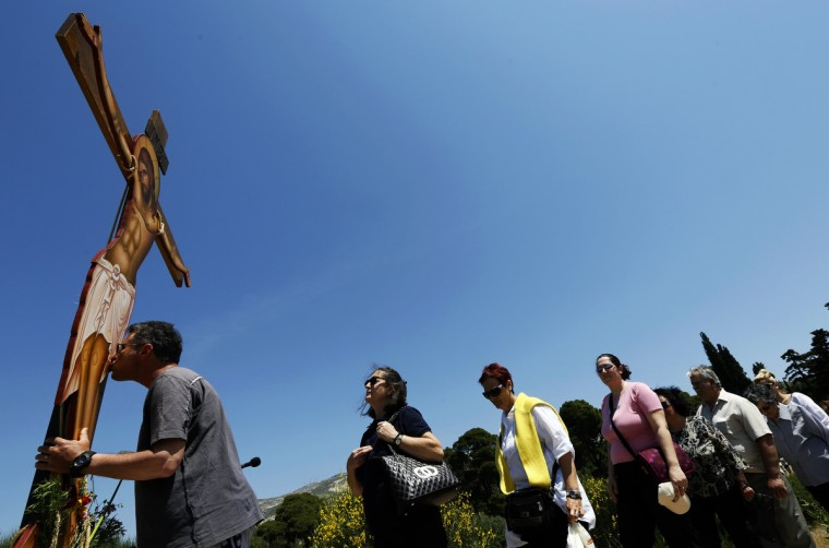 Greek Orthodox faithful pay their respect in front of a figure of a crucified Jesus Christ on Good Friday at Penteli monastery north of Athens. Orthodox Christians around the world celebrate Easter on Sunday. (Yannis Behrakis/Reuters photo)