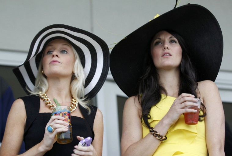 Race spectators await the running of the 139th Kentucky Derby horse race at Churchill Downs in Louisville, Kentucky. (John Sommers II/Reuters)
