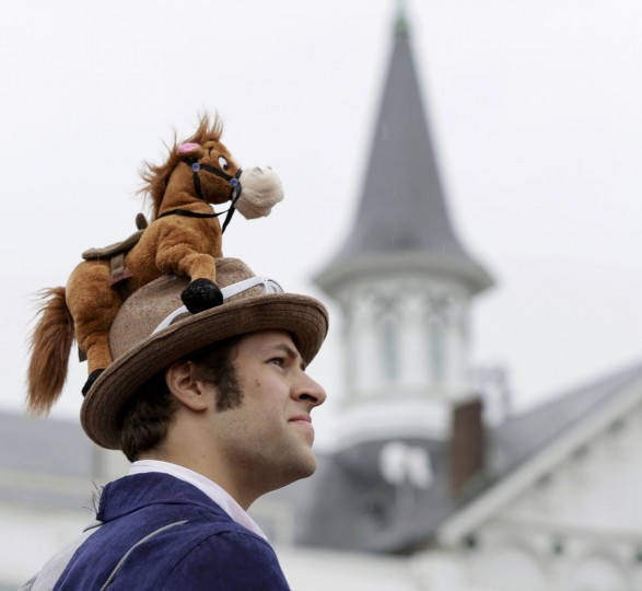 Race patron Rick Stewart wears a hat with a toy horse perched on top before the running of the 139th Kentucky Derby horse race at Churchill Downs in Louisville, Kentucky. (John Gress/Reuters)