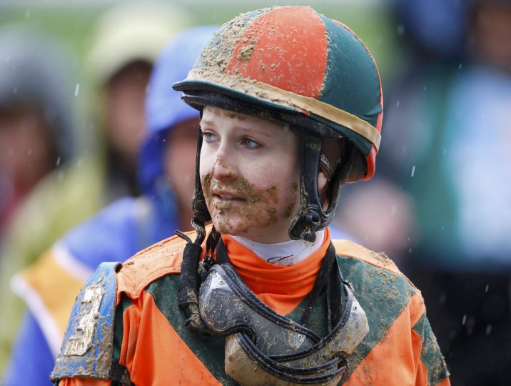 Jockey Rosie Napravnik walks away with a mud-covered face following the 7th race leading up to the running of the 139th Kentucky Derby horse race at Churchill Downs in Louisville, Kentucky. (Jeff Haynes/Reuters)
