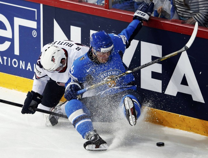 Finland's Janne Jalasvaara (R) and Team USA's Bobby Butler fall as they fight for the puck during their 2013 IIHF Ice Hockey World Championship preliminary round match at the Hartwall Arena in Helsinki. (Grigory Dukor/Reuters)