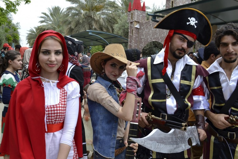 Students of the Law department dress in costumes during a celebration at their graduation ceremony in Diyala, 65 km (40 miles) northeast of Baghdad, May 2, 2013. (Mohammed Adnan/Reuters photo)
