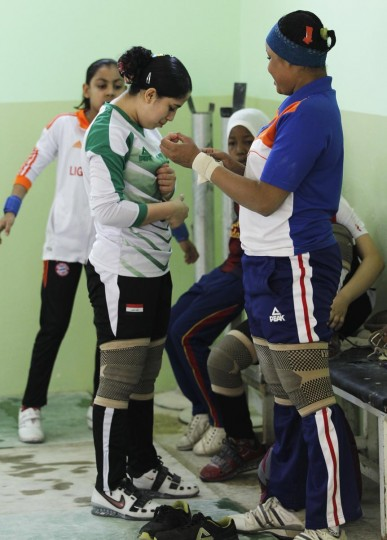 Iraqi weightlifters prepare for a training session at a gym in Sadr city in Baghdad, April 28, 2013. The team of female weightlifters are set to represent Iraq in the Asian Championship in Qatar next month. (Mohammed Ameen/Reuters)