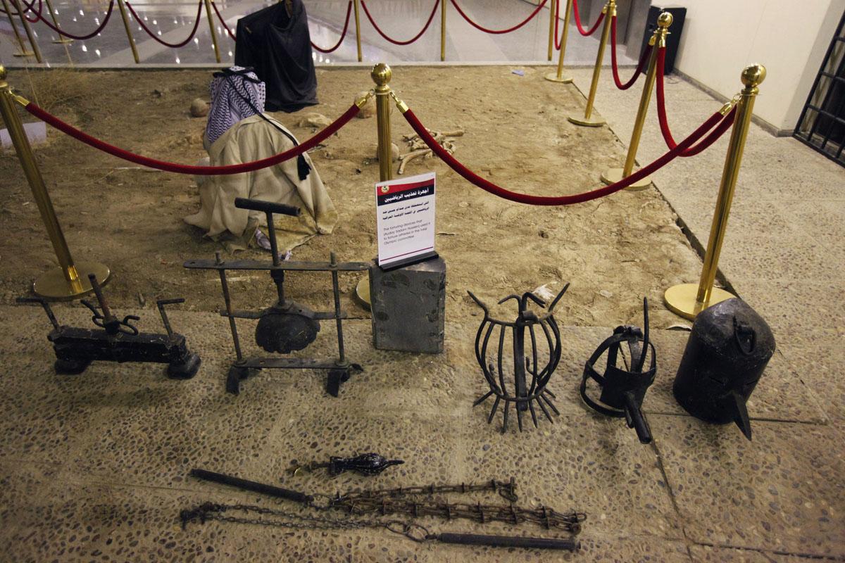 May 24 Photo Brief: Saddam's torture masks, self ...  May 24 Photo Br...