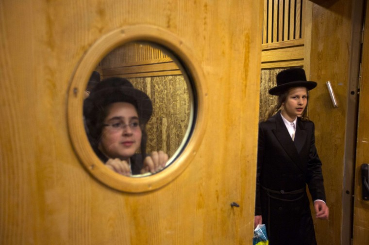 Ultra-Orthodox Jewish boys look at preparations for the wedding of the Chief Rabbi of Belz, Yissachar Dov Rokeach's grandson, in Jerusalem. Local media said some 25 thousand people gathered on Tuesday to celebrate the wedding of the first grandson of the current leader of the Belz Hasidic dynasty, which is one of the largest Hasidic movements in the world. (Ronen Zvulun/Reuters)