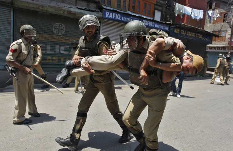 Indian police personnel carry their injured comrade during a clash with supporters of the Jammu Kashmir Liberation Front (JKLF), a separatist party, in Srinagar. Dozens of JKLF supporters held a protest against the government's decision not to allow JKLF chairman Mohammad Yasin Malik to visit the earthquake-affected areas of the Doda region to distribute aid to victims, local media reported. (Danish Ismail/Reuters photo)