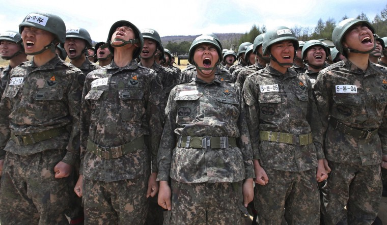 Members of the South Korean special forces take part in a military drill in Yeongcheon, southeast of Seoul in this picture provided by Yonhap. The two Koreas remain technically at war under a mere truce that ended hostilities in their 1950-53 conflict and North Korea, angry at U.N. sanctions and joint South Korean-U.S. military drills, has threatened both countries with nuclear attack in recent weeks. (Han Jong-chan/Yonhap via Reuters)