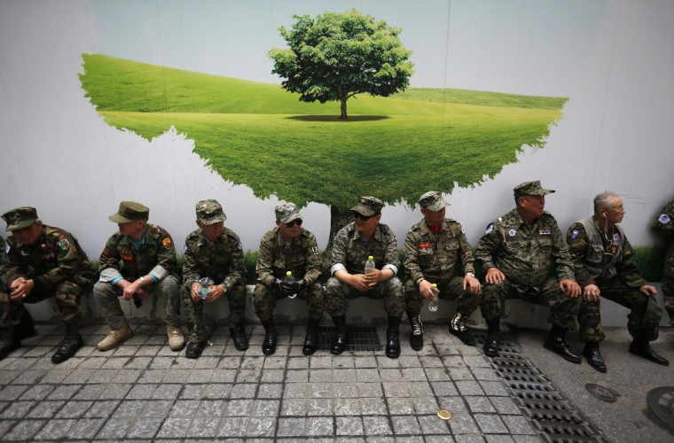 War veterans take a rest during an anti-Japan rally in front of Japanese embassy in Seou. The rally was held to denounce Abe and demand an official apology for Japan's war crimes during World War Two. (Kim Hong-Ji/Reuters photo)