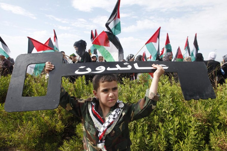 "A Palestinian boy holds up a symbolic key during a march to mark the 65th anniversary of Nakba near the United Nations Interim Force in the Lebanon (UNIFIL) headquarters in the town of Naqoura May 13, 2013. Palestinians will mark ""Nakba"" (Catastrophe) on May 15 to commemorate the expulsion or fleeing of hundreds of thousands of their brethren from their homes in the war that led to the founding of Israel in 1948. (Ali Hashisho/Reuters)"