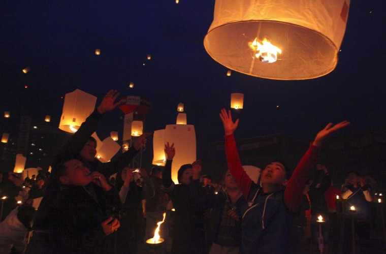 Buddhist believers release paper lanterns as they pay homage to Buddha on Visakha Puja day, also known as Vesak Day, at the Nadam stadium in Ulan Bator, May 25, 2013. (Mareike Guensche/Reuters)
