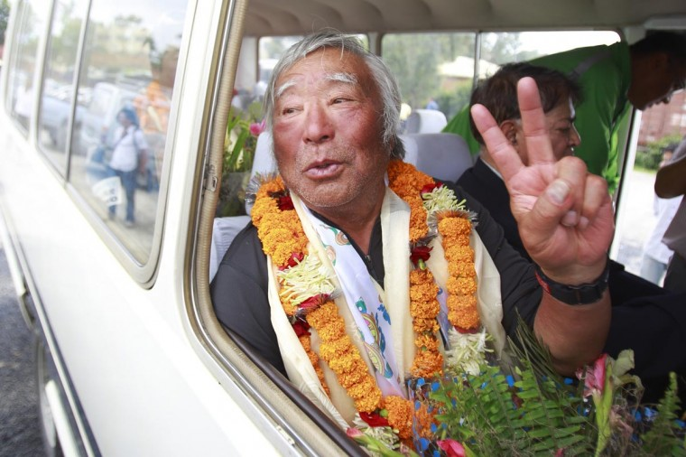 Japanese mountain climber Yuichiro Miura, 80, shows the victory sign upon his arrival at the airport after climbing Mount Everest, in Kathmandu May 26, 2013. Miura, who has had four heart surgeries, reached the top of Mount Everest on Thursday becoming the oldest person to conquer the world's highest mountain. Miura, who first climbed Everest in 2003 and repeated the feat five years later, takes the oldest climber record from Nepal's Min Bahadur Sherchan, who reached the summit at the age of 76 in 2008. (Navesh Chitrakar/Reuters)