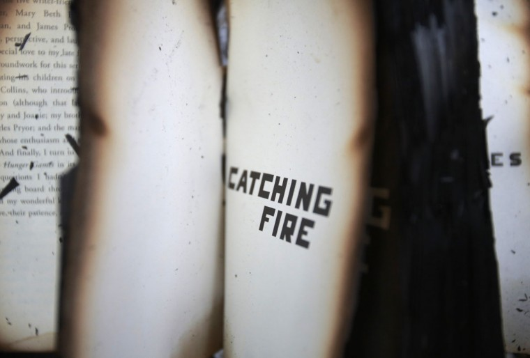 "A burnt book that reads ""Catching Fire"" is pictured at the scene of a fire at Thamel, a major tourist hub in Kathmandu, Nepal. (Navesh Chitrakar/Reuters)"