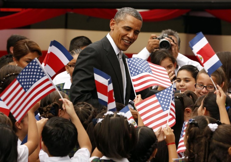 U.S. President Barack Obama greets schoolchildren at Casa Amarilla during his visit to San Jose, Costa Rica May 3, 2013. The children sang to Obama and Costa Rican President Laura Chinchilla. (Kevin Lamarque/Reuters)