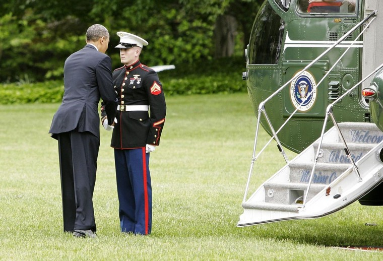 U.S. President Barack Obama returns to shake the hand of a U.S. Marine, after forgetting to return his salute, before departing for graduation ceremonies at the Naval Academy, via the Marine One helicopter, from the White House in Washington May 24, 2013. (Jonathan Ernst/Reuters)