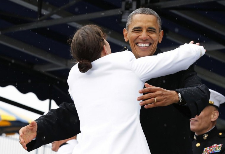 U.S. President Barack Obama is hugged by graduate Alexis Marsia Werner at the U.S. Naval Academy commencement ceremony in Annapolis, May 24, 2013. (Larry Downing/Reuters)