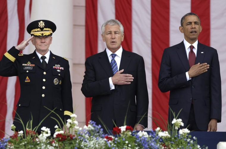 U.S. President Barack Obama (R) stands for the national anthem with Chairman of the Joint Chiefs of Staff U.S. Army General Martin Dempsey (L) and U.S. Defense Secretary Chuck Hagel (C) as he takes the stage for remarks at the Memorial Day observances at Arlington National Cemetery in Arlington, Virginia, May 27, 2013. (Jonathan Ernst/Reuters)