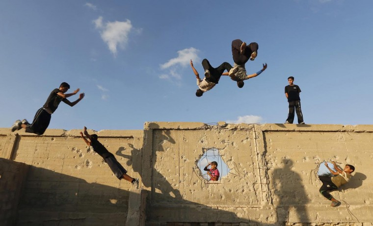 Palestinian youths practice their parkour skills in Khan Younis in the southern Gaza Strip September 12, 2012. Training is held in cemeteries, and in former Israeli settlements. (Mohammed Salem/Reuters)