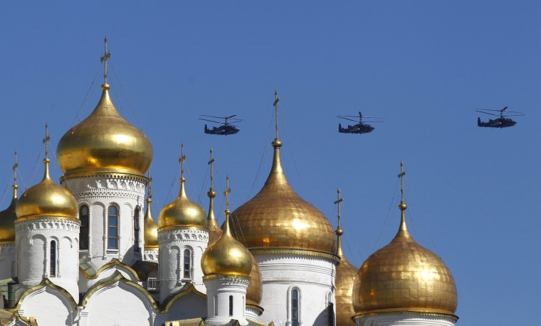 Military helicopters fly over an Orthodox Christian church during a rehearsal for the Victory Day parade in Moscow. Russia marks victory over Nazi Germany in World War Two every year on May 9. (Mikhail Voskresensky/Reuters photo)