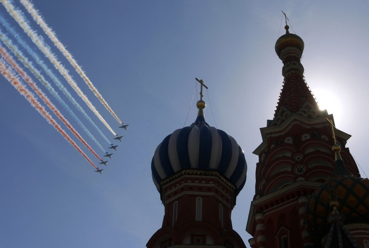 A formation of jets fly over St. Basil's Cathedral during the Victory Parade in Moscow. Russia commemorates the 68th anniversary of the Soviet Union's victory over Nazi Germany on May 9. (Maxim Shemetov /Reuters photo)