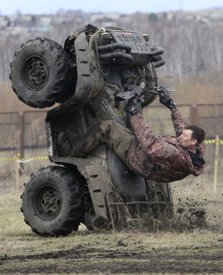 """A rider performs before the """"Kings of the Off-road"""" quad bike amateur regional race in a Siberian boggy district near the village of Kozhany, some 200 km (124 miles) southwest of Krasnoyarsk. (Ilya Naymushin/Reuters photo)"""
