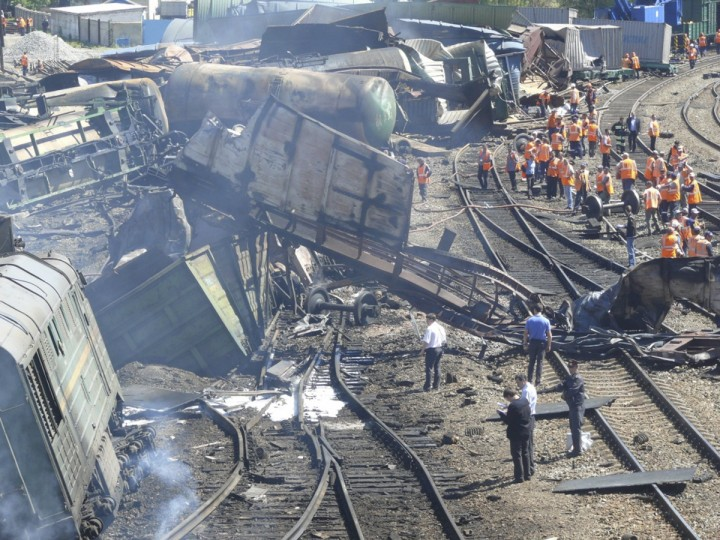 Emergency Ministry staff work at the site of an explosion in the Belaya Kalitva station in the south Russian Rostov-on-Don region. The explosion on a freight train carrying chemicals and oil products hurled part of a railcar into a residential block in southern Russia. (Russian Emergencies Ministry photo/via Reuters)