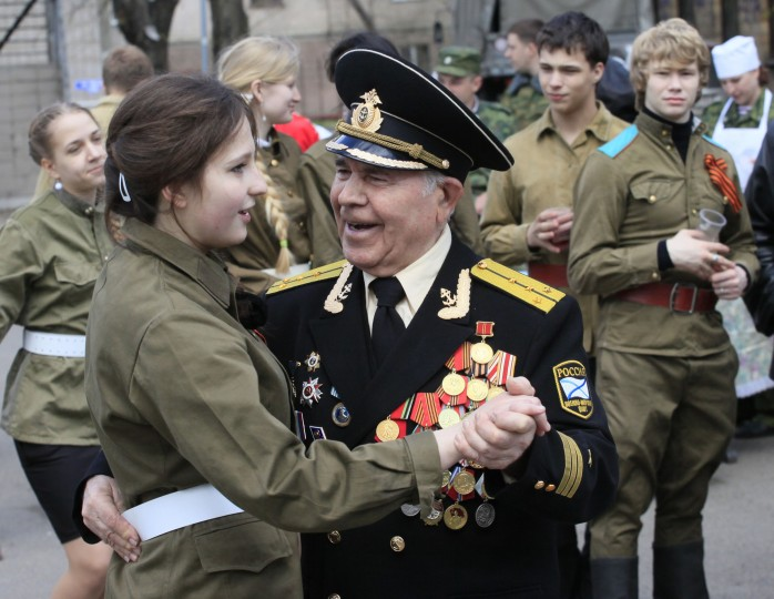 A World War Two veteran dances with a girl dressed in a Red Army uniform during a street performance ahead of Victory Day in the Russian Siberian city of Krasnoyarsk. Russia marks its victory over Nazi Germany in World War Two every year on May 9. (Ylia Naymushin/Reuters photo)