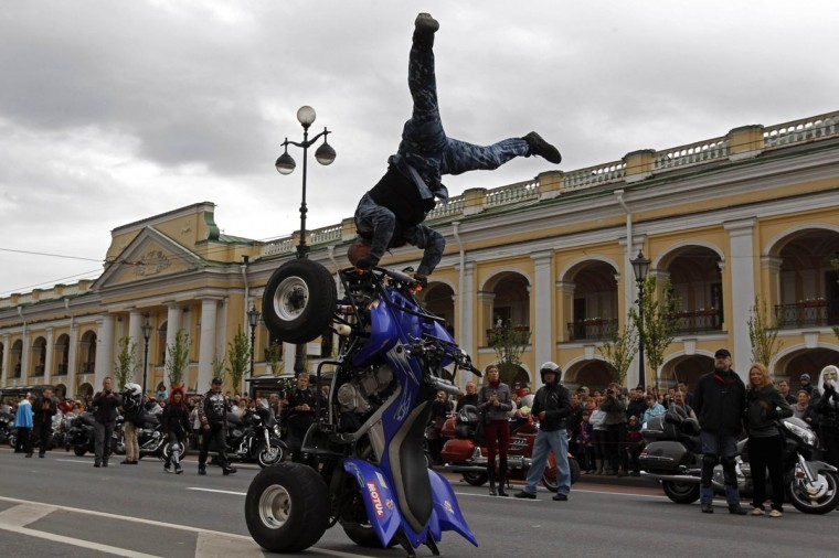 A biker demonstrates his skills on Nevsky Avenue in St. Petersburg May 26, 2013. Citizens of St. Petersburg on Sunday celebrated the 310th anniversary of the city's foundation by Russian Tsar Peter the Great. (Alexander Demianchuk/Reuters)