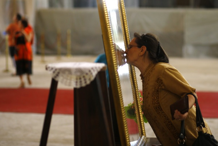 A worshipper kisses an icon of Christ as she prays during Good Friday at the St. Sava temple in Belgrade. Serbia and other Eastern Orthodox countries celebrate Easter this weekend. (Marko Djurica/Reuters photo)