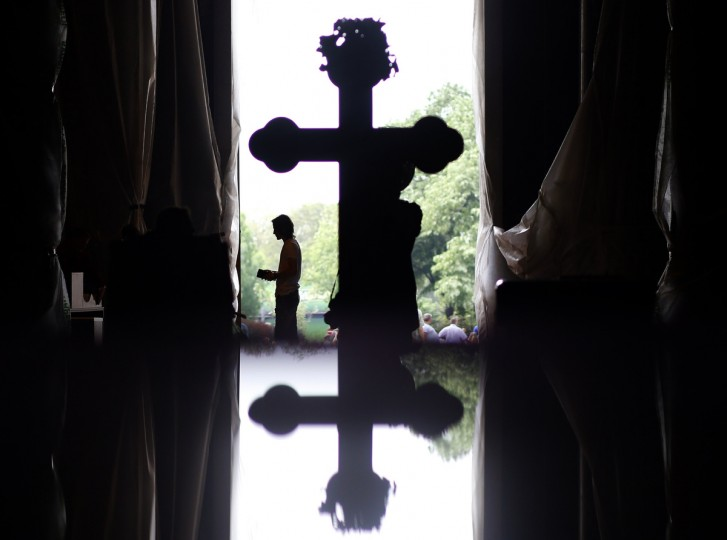 A worshipper prays during Good Friday at the St. Sava temple in Belgrade. Serbia and other Eastern Orthodox countries celebrate Easter this weekend. (Marko Djurica/Reuters photo)