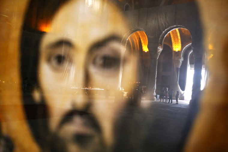 Worshippers, reflected on a glass case of an icon of Christ, pray during Good Friday at the St. Sava temple in Belgrade. Serbia and other Eastern Orthodox countries celebrate Easter this weekend. (Marko Djurica/Reuters photo)