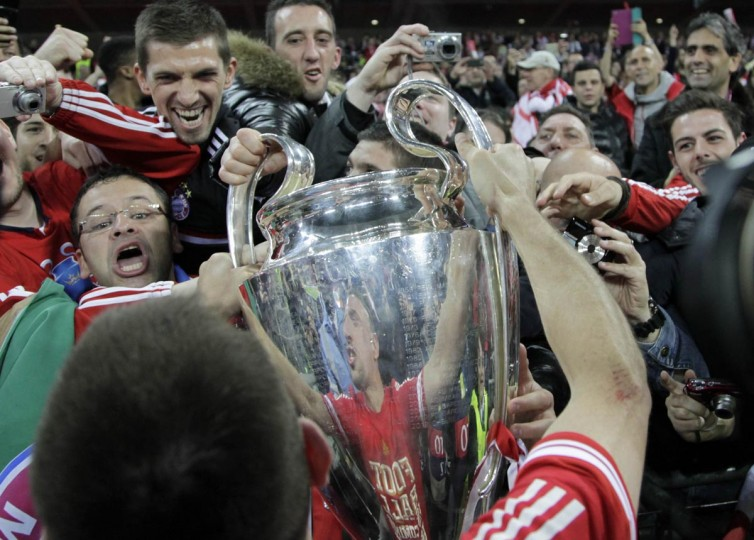Bayern Munich's Franck Ribery (foreground) holds up the trophy to fans as he celebrates after winning the Champions League final soccer match at Wembley stadium in London May 25, 2013. Bayern Munich beat Borussia Dortmund 2-1 in an all-German Champions League final on Saturday to become European champions for the fifth time. (Stefan Wermuth/Reuters)