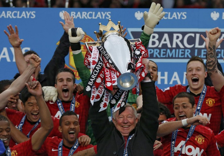 Manchester United manager Alex Ferguson (C) lifts the English Premier League trophy at Old Trafford stadium in Manchester, northern England May 12, 2013. Ferguson's last home match in charge of Manchester United ended in a low-key 2-1 Premier League win over Swansea City as the Old Trafford crowd gave their long-serving manager a warm and emotional send-off on Sunday. (Phil Noble/Reuters)