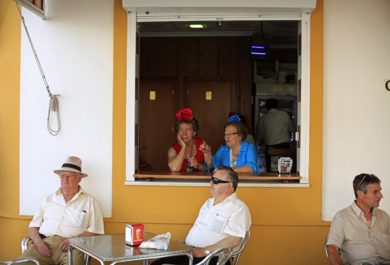 Pilgrims from the Fuengirola fellowship are seen in a bar as they make their way to the shrine of El Rocio in Coria del Rio, near Seville. Every spring hundreds of thousands of devotees converge at a shrine to pay homage to the Virgin del Rocio during an annual pilgrimage which combines religious fervor and festive color. (Marcelo del Pozo/Reuters)