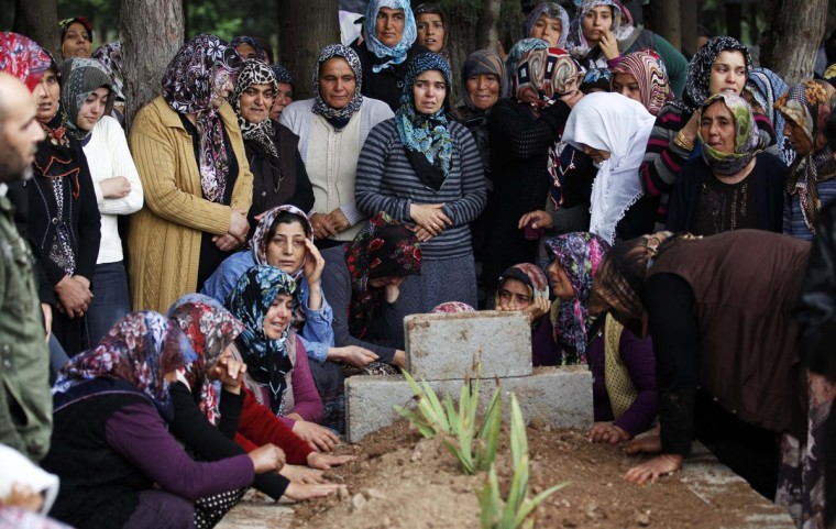 Relatives of Ahmet Uyan, 45, and Ahmet Ceyhan, 23, who were killed in yesterday's car bombings mourn in the town of Reyhanli of Hatay province near the Turkish-Syrian border May 12, 2013. Turkey said on Sunday it believed fighters loyal to Syrian President Bashar al-Assad were behind twin car bombings that killed 46 people in a Turkish border town. (Umit Bektas/Reuters)