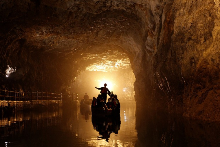 Tourists on traditional boats sail in the Beihai military water tunnels on the island of Nangan in the Matsu archipelago, off northern Taiwan. The Matsu archipelago, which was once front line against China, is now a military tourist spot. (Pichi Chuang/Reuters)