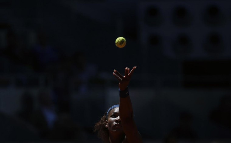 Serena Williams of the U.S. serves the ball to Maria Sharapova of Russia during their women's singles final match at the Madrid Open tennis tournament in Madrid May 12, 2013. (Susana Vera/Reuters)