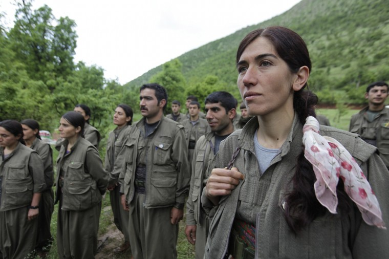 Kurdistan Workers Party (PKK) fighters stand at formation in northern Iraq. The first group of Kurdish militants to withdraw from Turkey under a peace process entered northern Iraq on Tuesday, and were greeted by comrades from the Kurdistan Workers Party (PKK), in a symbolic step towards ending a three-decades-old insurgency. The 13 men and women, carrying guns and with rucksacks on their backs, arrived in the area of Heror, near Metina mountain on the Turkish-Iraqi border, a Reuters witness said. (Azad Lashkari/Reuters)