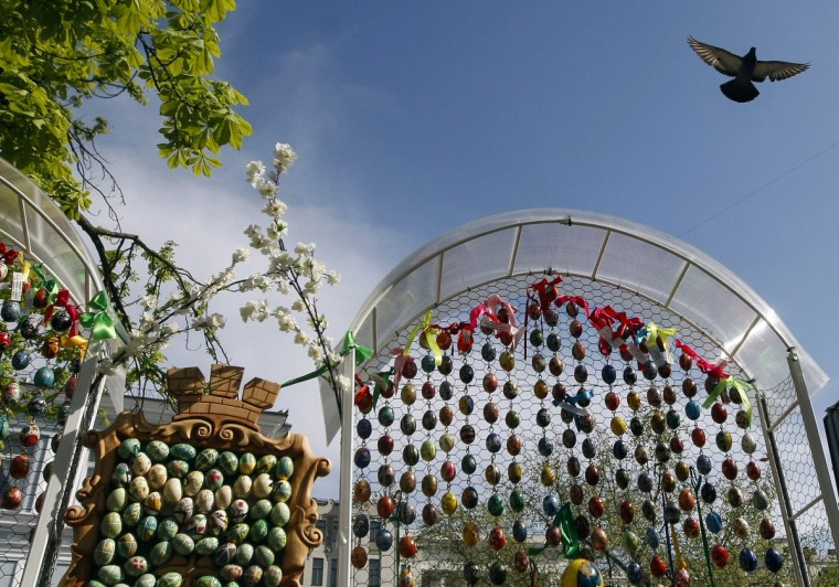 A pigeon flies above an installation made of painted wooden eggs, attributes of the Orthodox Easter, in central Kiev, Ukraine. Orthodox believers will celebrate Easter on May 5. (Sergii Polezhaka/Reuters photo)