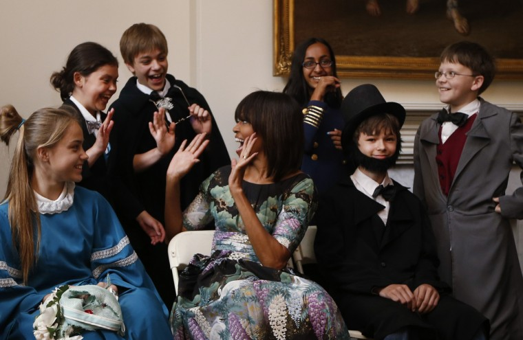 U.S. first lady Michelle Obama reacts with school children from Willow Springs Elementary School in Fairfax, Virginia, as they participate in a play about the emancipation of slaves during Abraham Lincoln's presidency, at historic Decatur House in Washington. Michelle Obama visited to site where some of the last slaves in Washington lived, and where a one-million dollar grant was announced on Wednesday to help preserve the building. (Jason Reed/Reuters)