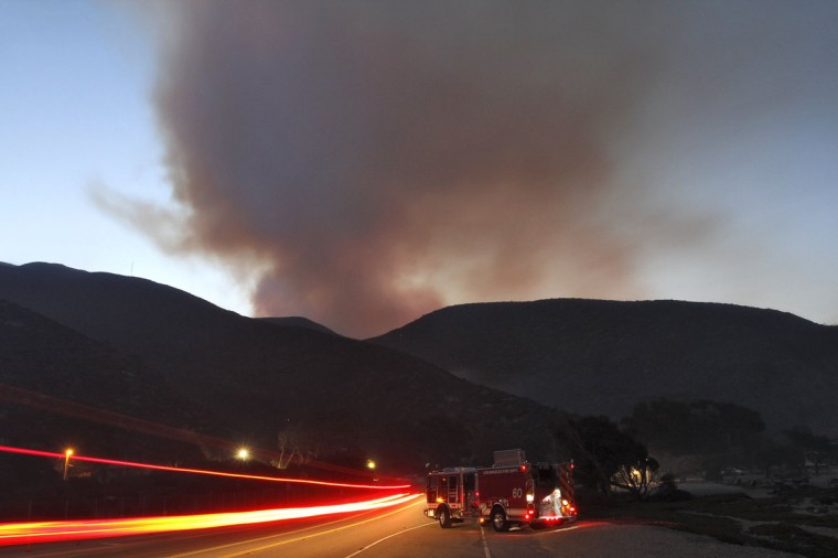 A fire engine is parked on Pacific Coast Highway as the Springs Fire burns in the hills at Point Mugu State Park. (Jonathan Alcorn/Reuters)