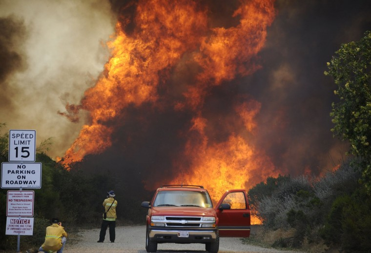 Photographers take pictures of The Springs Fire near Camarillo in Ventura County May 2, 2013. (Gene Blevins/Reuters)
