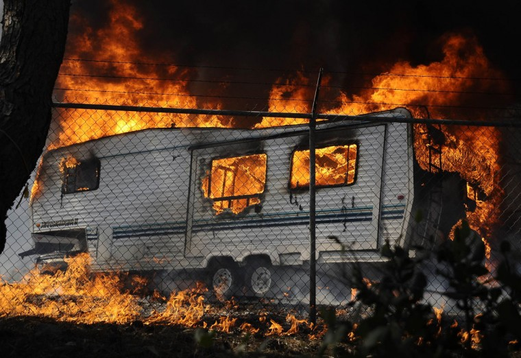 A trailer is engulfed in flames as a raging wildfire pushes towards the coast in Camarillo May 2, 2013. (Gene Blevins/Reuters)