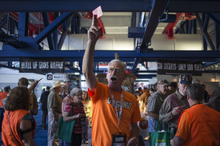 Tommy Joost of Victoria, Texas holds up a raffle ticket to win a gun during the National Rifle Association (NRA)'s annual meeting at the George R. Brown Convention Center in Houston. (Adrees Latif/Reuters)