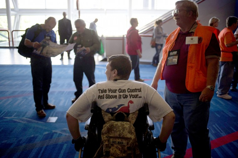 Veteran James Holman from Houston (C) arrives to the National Rifle Association (NRA)'s annual meeting at the George R. Brown Convention Center in Houston, Texas. (Adrees Latif/Reuters)