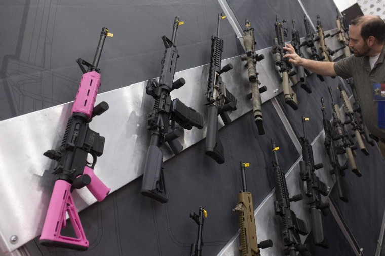 A pink assault rifle hangs among others at an exhibit booth at the George R. Brown convention center, the site for the National Rifle Association's (NRA) annual meeting in Houston, Texas May 5, 2013. The National Rifle Association is showcasing women members and emphasizing that increasingly it's not just men who own firearms and oppose gun-control efforts. Female members